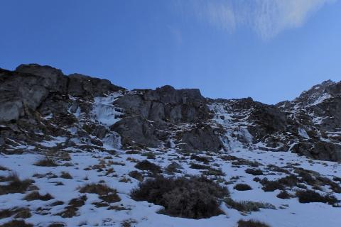 The Enticer, WI2/3, 80m. On the left, and another unclimbed flow on the right.