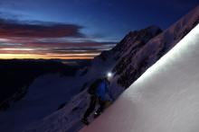 Tim Elson climbing by headtorch on the Syme Ridge (Mt. Tasman)